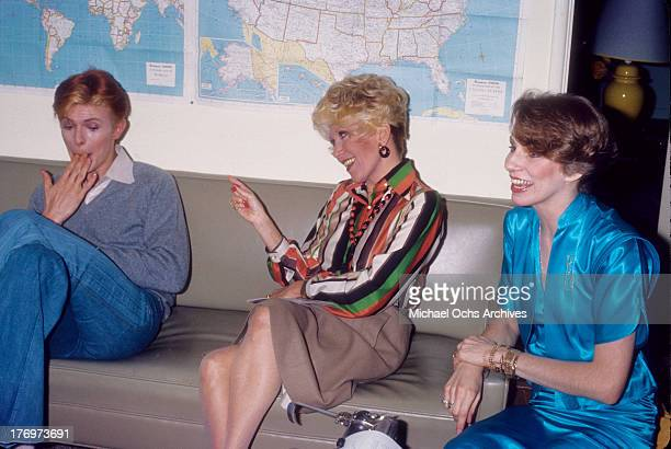David Bowie, Rona Barrett and Angela Bowie backstage on 'Good Morning America' by Rona Barrett in February, 1976 in Los Angeles, California.