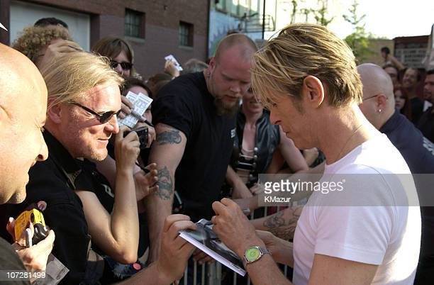 David Bowie signs autographs for fans outside the Chance club in Poughkeepsie