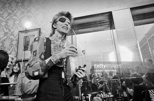 David Bowie wearing an eye patch conducts a press conference at the Amstel Hotel Amsterdam Netherlands on February 13 1974