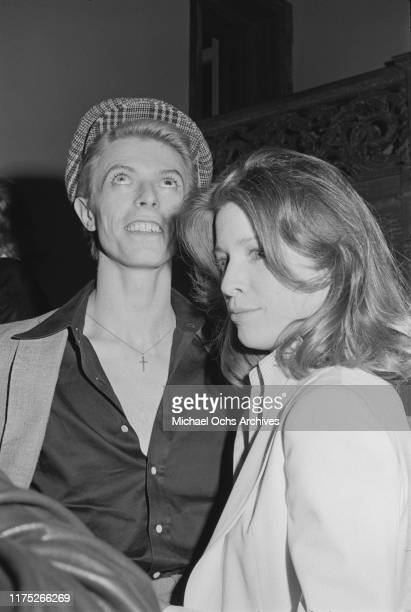 David Bowie with a guest at a reception given by the American Film Institute for film director Michelangelo Antonioni at Greystone Mansion Beverly...