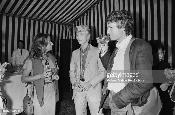 David Bowie with Danielle Thompson and Jean Jacques Annaud after his triumph at he Hippodrome d'Auteuil in the Paris suburbs 8th June 1983