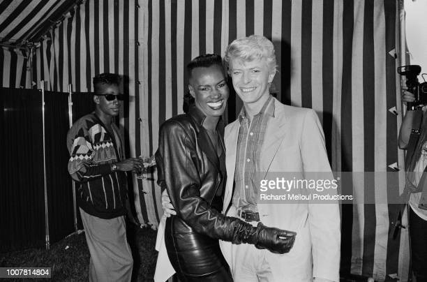 David Bowie with Grace Jones after his triumph at he Hippodrome d'Auteuil in the Paris suburbs 8th June 1983