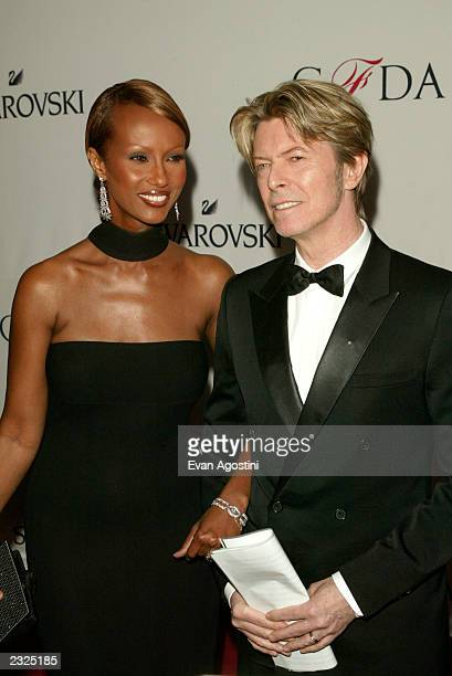 David Bowie with Iman arriving at the 2002 CFDA Fashion Awards at The New York Public Library in New York City June 3 2002 Photo Evan...