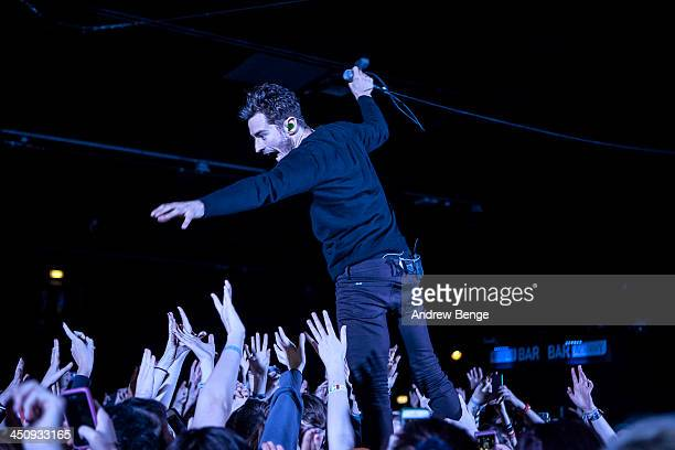David Boyd of New Politics performs on stage at Manchester Arena on November 20 2013 in Manchester United Kingdom