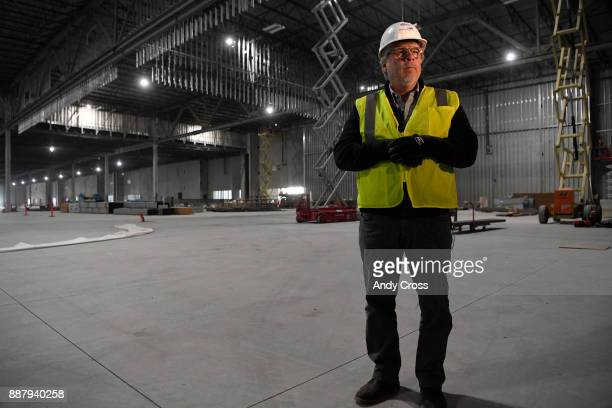 David Bray RIDA Development Corporation VP architecture and construction stands in the Aurora Ballroom and Exhibit Hall in the convention center of...