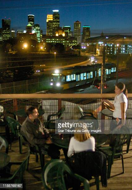 David Brewster / Star Tribune Thursday_06/17/04_Mpls Enjoying a nice summer evening and the view of downtown Minneapolis on the deck at the Baja Bar...