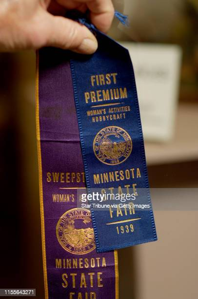 David Brewster/Star Tribune Thursday_09/01/05_FalconHeights - - - - - - - Forrest Poppe, 87 yrs. Old, holds one of the first ribbons he won at the...