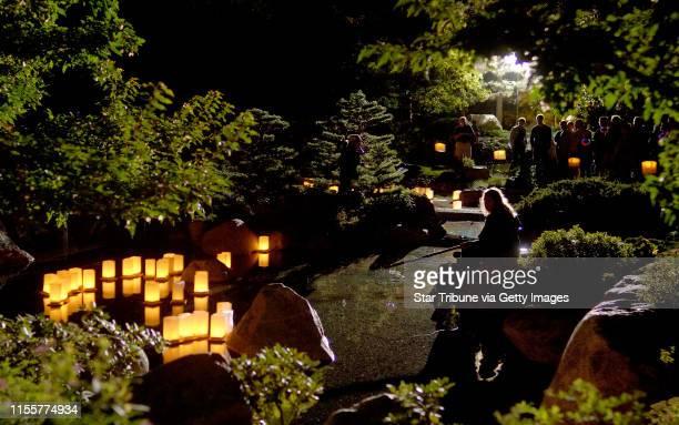 David Brewster/StarTribune Sunday_08/21/05_StPaul Floating paper lanterns were lit at dusk at the Japanese Lantern Festival at Como Park Convervatory...