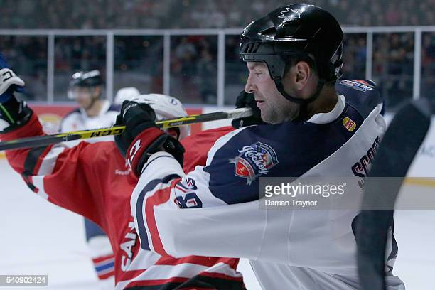 David Broll of Canada and John Scott of USA collide during the match between Team USA and Team Canada at Rod Laver Arena on June 17 2016 in Melbourne...