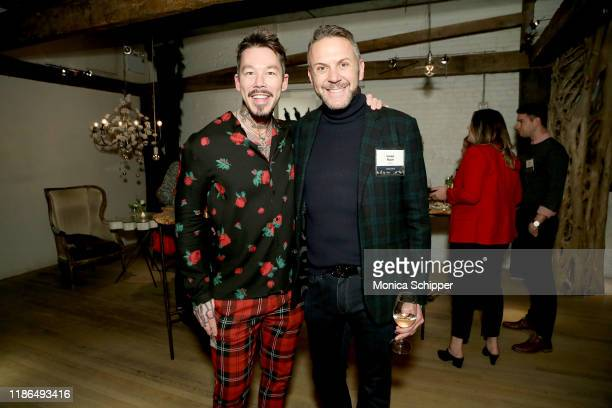 David Bromstad and Loren Ruch attend the Discovery Inc Holiday Press Party 2019 at ABC Kitchen on December 03 2019 in New York City