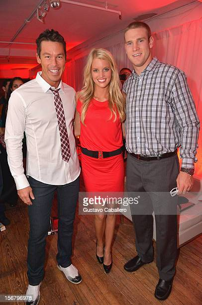 David Bromstad Lauren Tannehill and Ryan Tannehill attend the TigerDirectcom And Intel's Holiday Tech Bash on November 20 2012 in Miami Florida