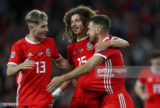 David Brooks and Ethan Ampadu of Wales congratulate Aaron Ramsey of Wales after he scores his teams third goal during the UEFA Nations League B group...