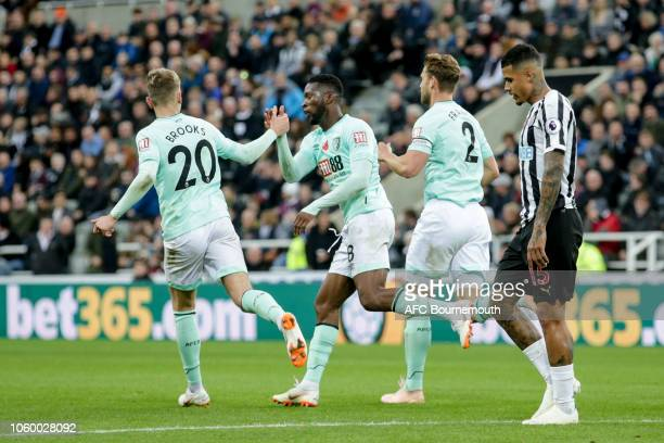David Brooks congratulates teammate Jefferson Lerma of Bournemouth after Lerma makes it 21 during the Premier League match between Newcastle United...