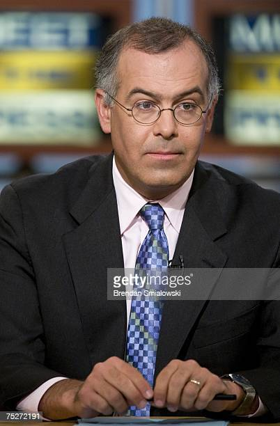 David Brooks New York Times columnist listens during a live taping of Meet the Press at NBC July 8 2007 in Washington DC Senator Chuck Hagel was...