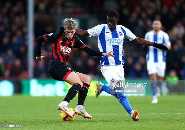 David Brooks of AFC Bournemouth battles for possession with Yves Bissouma of Brighton and Hove Albion during the Premier League match between AFC...