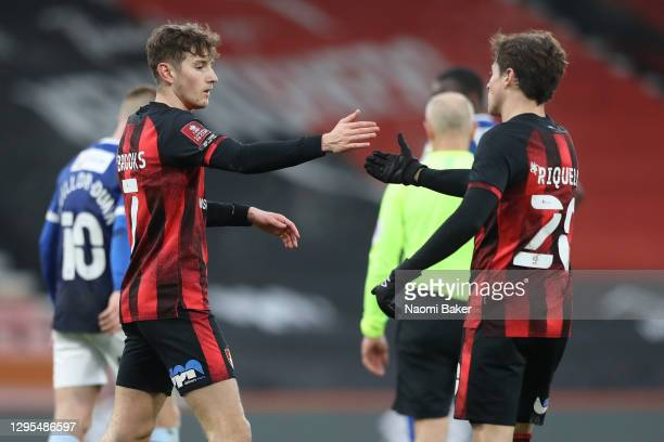 David Brooks of AFC Bournemouth celebrates with Rodrigo Riquelme after scoring their team's first goal during the FA Cup Third Round match between...