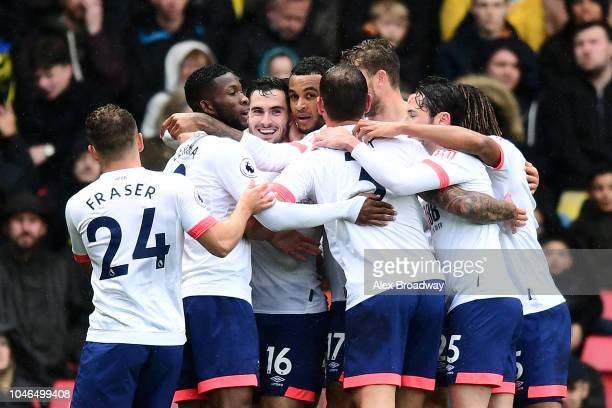David Brooks of AFC Bournemouth celebrates with teammates after scoring his team's first goal during the Premier League match between Watford FC and...