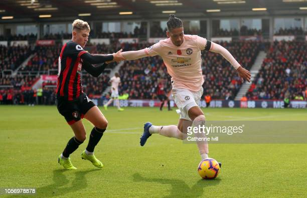 David Brooks of AFC Bournemouth competes with Chris Smalling of Manchester United during the Premier League match between AFC Bournemouth and...