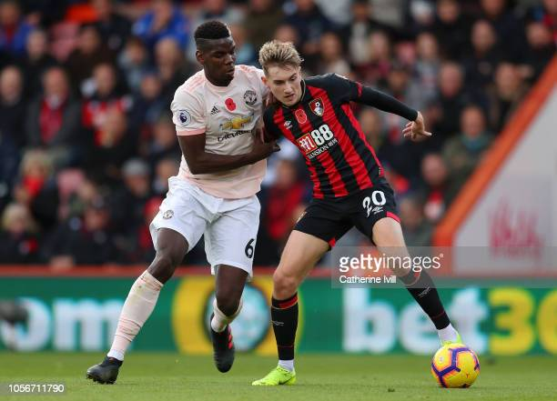 David Brooks of AFC Bournemouth is challenged by Paul Pogba of Manchester United during the Premier League match between AFC Bournemouth and...