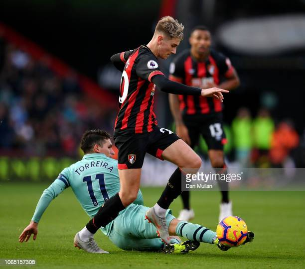 David Brooks of AFC Bournemouth is tackled by Lucas Torreira of Arsenal during the Premier League match between AFC Bournemouth and Arsenal FC at...