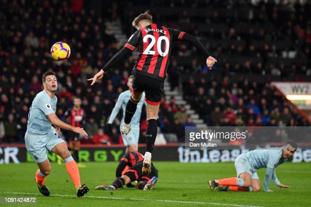 David Brooks of AFC Bournemouth jumps for the ball during the Premier League match between AFC Bournemouth and Chelsea FC at Vitality Stadium on...