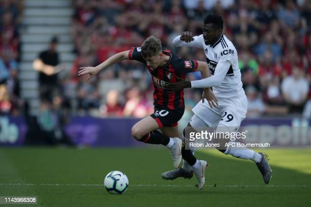 David Brooks of Bournemouth and AndreFrank Zambo Anguissa of Fulham during the Premier League match between AFC Bournemouth and Fulham FC at Vitality...