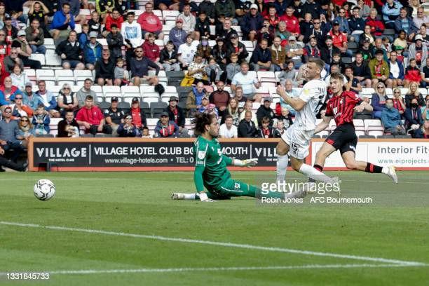 David Brooks of Bournemouth beats keeper Franco Ravizzoli of MK Dons and scores a goal to make it 5-0 during the Carabao Cup 1st Round match between...