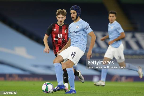 David Brooks of Bournemouth closes down Eric Garcia of Manchester City during the Carabao Cup Third Round match between Manchester City and AFC...