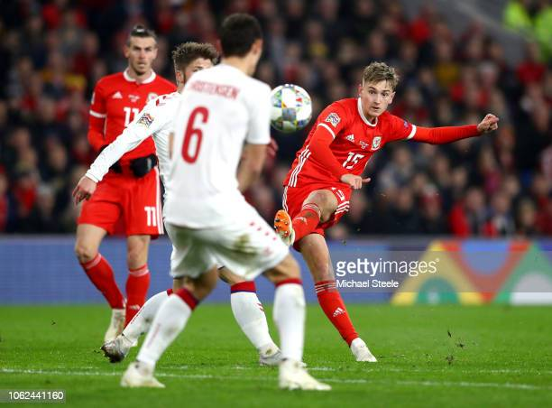 David Brooks of Wales shoots as Andreas Christensen of Denmark attempts to block during the UEFA Nations League Group B match between Wales and...