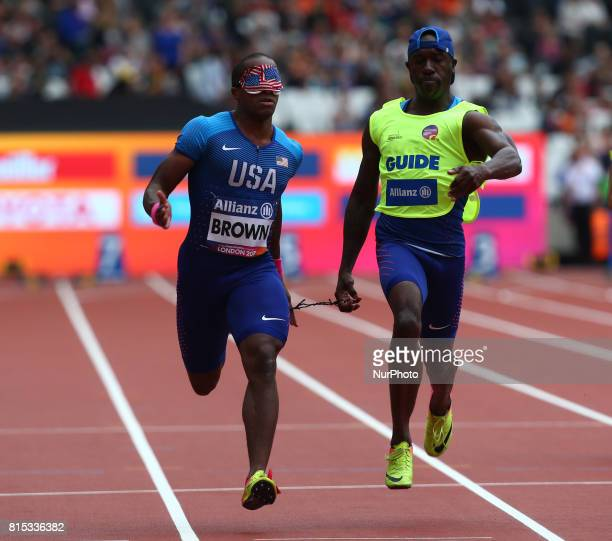 David Brown of USA and Guide Jerome Avery Men's 100m T11 Round 1 Heat 3 during IPC World Para Athletics Championships at London Stadium in London on...