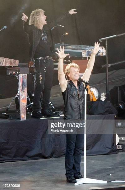 David Bryan and Jon Bon Jovi of Bon Jovi performs live during a concert at the Waldbuehne on June 18 2013 in Berlin Germany