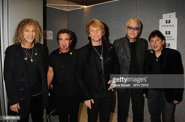 David Bryan Tico Torres and Jon Bon Jovi of Bon Jovi and guests pose backstage during the MTV Europe Music Awards 2010 at La Caja Magica on November...