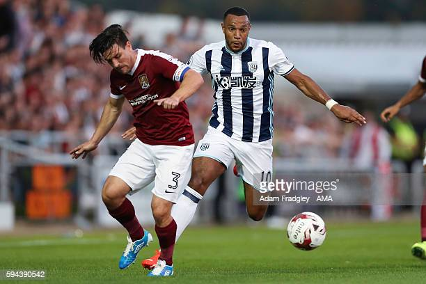 David Buchanan of Northampton Town and Matt Phillips of West Bromwich Albion during the EFL Cup fixture between Northampton Town and West Bromwich...