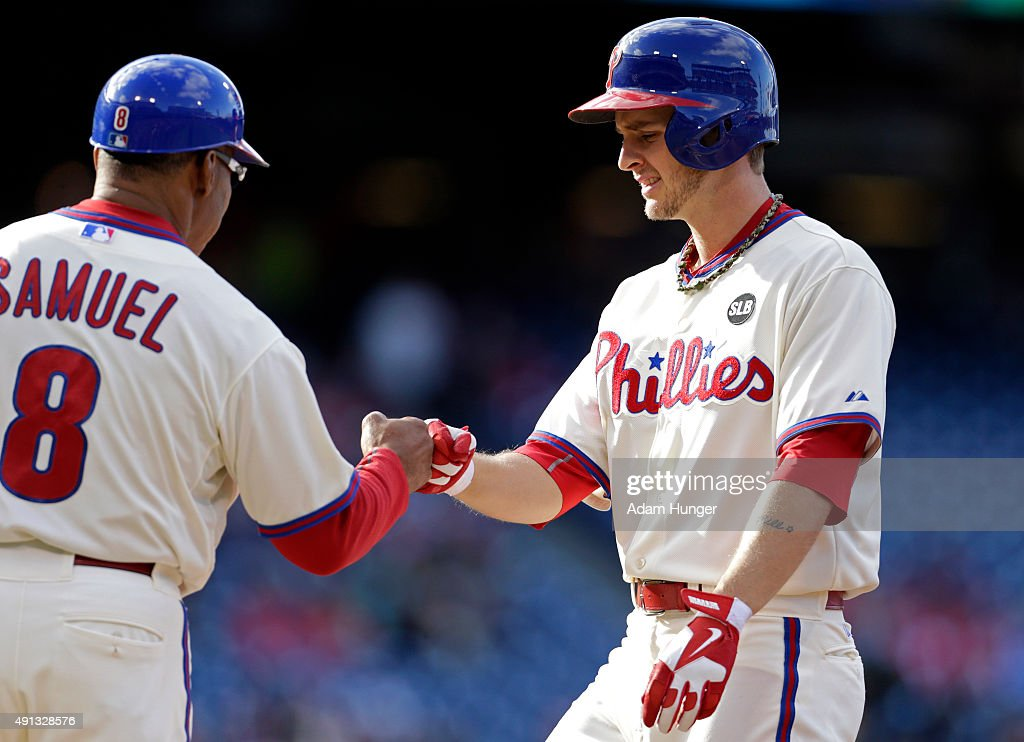 David Buchanan #55 of the Philadelphia Phillies is congratulated by Juan Samuel #8 of the Philadelphia Phillies after hitting a single during the fifth inning of an MLB game against the Miami Marlins at Citizens Bank Park on October 4, 2015 in Philadelphia, Pennsylvania. The Phillies defeated the Marlins 7-2.