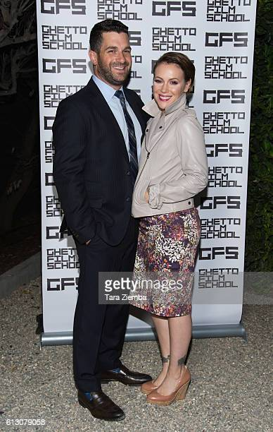David Bugliari and Alyssa Milano attend a benefit hosted by Brian Grazer for the Ghetto Film School on October 6 2016 in Beverly Hills California