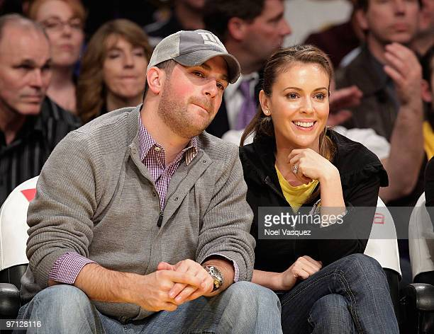 David Bugliari and Alyssa Milano attend a game between the Philadelphia 76ers and the Los Angeles Lakers at Staples Center on February 26 2010 in Los...