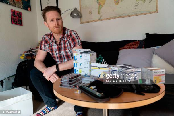David Burns who has type 1 diabetes, poses for a prepares his insulin pen to inject himself in his home in North London on February 24, 2019. -...