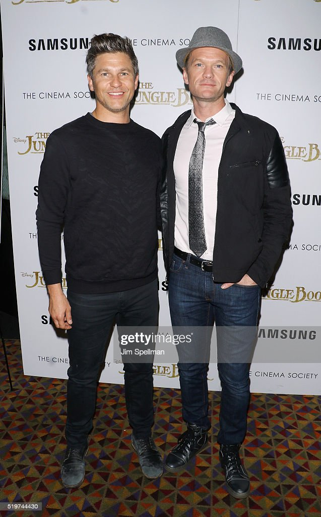 David Burtka (L) and husband Neil Patrick Harris attend the screening of 'The Jungle Book' hosted by Disney with The Cinema Society and Samsung at AMC Empire 25 theater on April 7, 2016 in New York City.