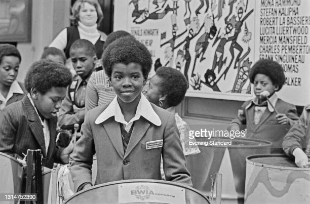 David Bute, a member of the Oxford Road Primary School Steel Band, playing a steelpan drum during a promotional tour with BWIA International, UK,...
