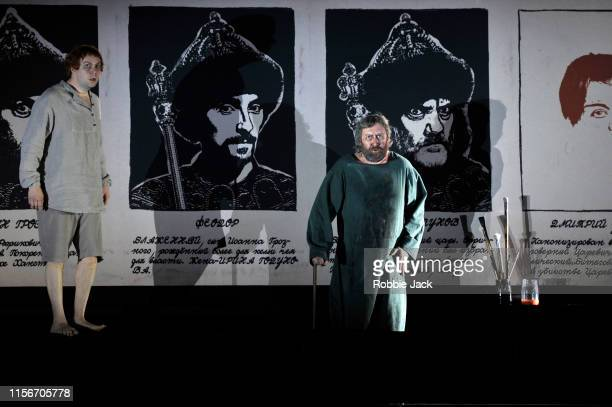 David Butt Philip as Grigory Otrepiev and Matthew Rose as Pimen in The Royal Opera's production of Modest Musorgsky's Boris Godunov directed by...