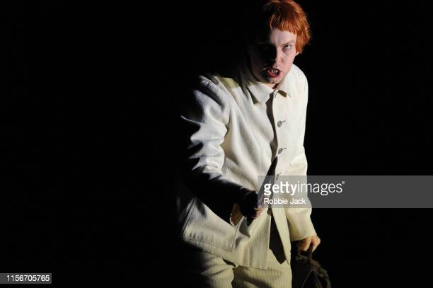 David Butt Philip as Grigory Otrepiev in The Royal Opera's production of Modest Musorgsky's Boris Godunov directed by Richard Jones and conducted by...