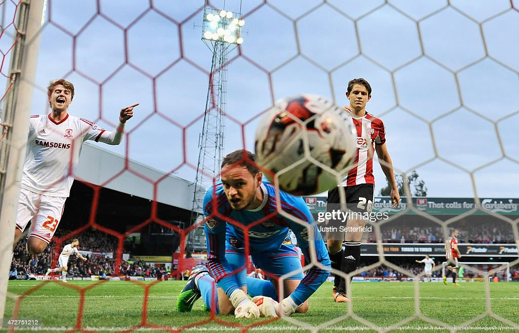 David Button of Brentford is unable to save Jelle Vossen (Not Seen) of Middlesbrough scoring the first goal during the Sky Bet Championship Playoff Semi-Final between Brentford and Middlesbrough at Griffin Park on May 8, 2015 in Brentford, England.