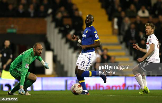 David Button of Fulham and Souleymane Doukara of Leeds United watch on as Tim Ream of Fulham scores an own goal during the Sky Bet Championship match...