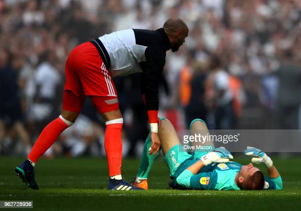 David Button of Fulham speaks with Sam Johnstone of Aston Villa following the Sky Bet Championship Play Off Final between Aston Villa and Fulham at...