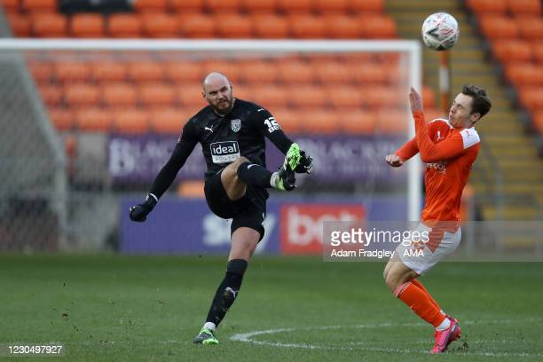 David Button of West Bromwich Albion clears the ball from Daniel Kemp of Blackpool during the FA Cup Third Round match between Blackpool and West...