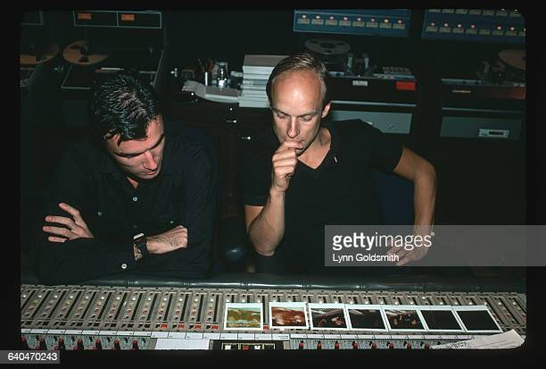 David Byrne lead singer and guitarist for the Talking Heads works with record producer Brian Eno in a recording studio