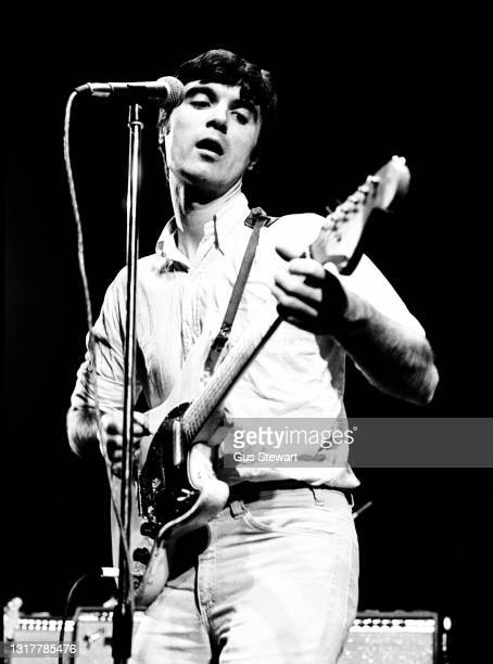 David Byrne of Talking Heads performs on stage at the Roundhouse, London, England, on January 29th, 1978. He is playing a Fender Duo Sonic guitar.