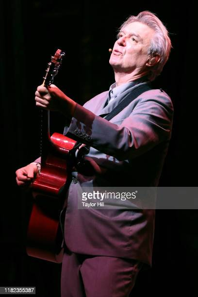 David Byrne performs during the opening night of David Byrne's American Utopia at Hudson Theatre on October 20 2019 in New York City
