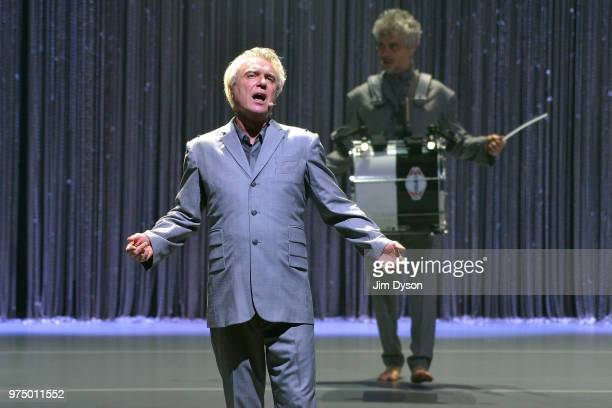 David Byrne performs live on stage during the first night of the European leg of his 'American Utopia' tour at New Theatre on June 14 2018 in Oxford...