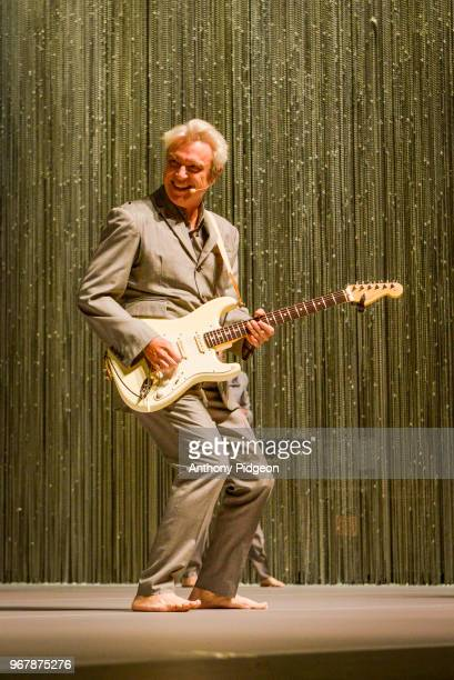 David Byrne performs on stage at Keller Auditorium during his American Utopia tour May 27 2018 in Portland Oregon